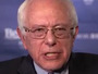 Sanders Targets Clinton on